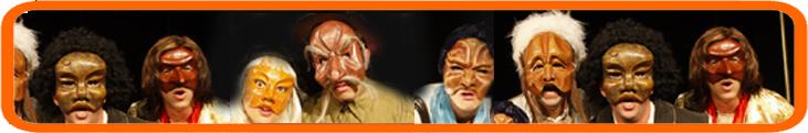 שחקני תיאטרון פסיק עוטים מסכות
